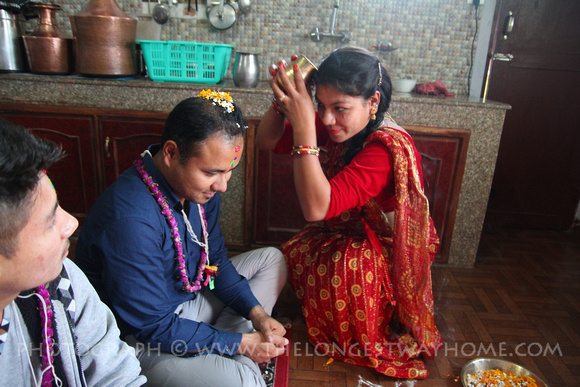 A Newari sister blesses her brother during Bhai Tika in Nepal