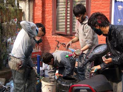 Nepalese boys prepare dye for Holi