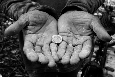 Man holding a coin