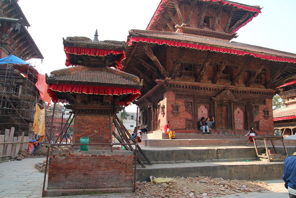 Scaffolding and scattered brick still in the main tourist attraction of Kathmandu Durbar Square (Basantapur)