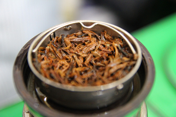Golden tips tea after they have been brewed
