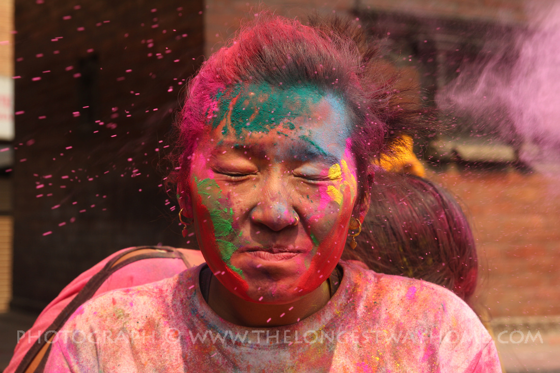 Girl covered in color during Holi