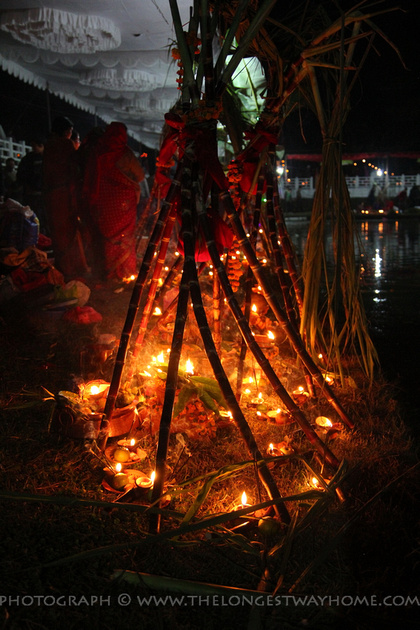 Triangular bamboo soop covering ritual candles and offerings during Chhath