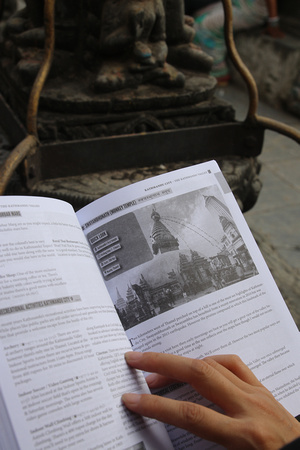 Tourist discovering new things with a guidebook to Nepal