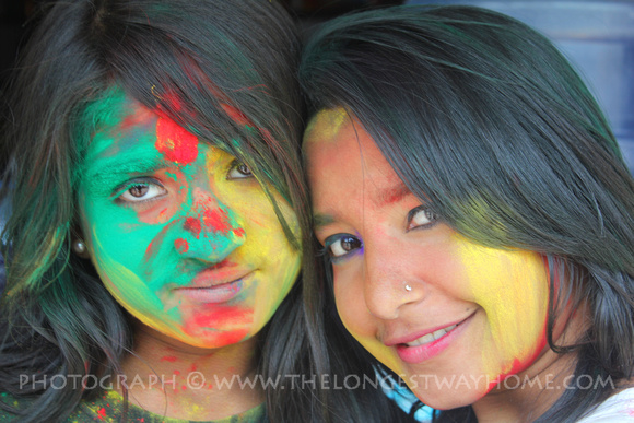 Two girls with painted faces during the Holi festival in Nepal