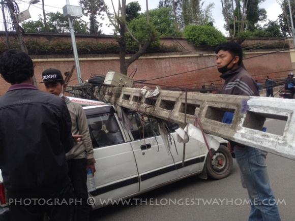 Electricity pole crushes car in Kathmandu