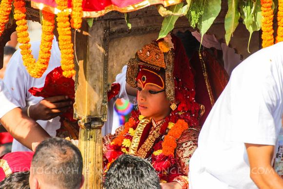 The Kumari Living Goddess rides her chariot through Kathmandu Durbar square during Indra Jatra