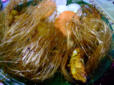 Chicken Reshami kebab covered in sugar string