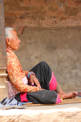 Old lady relaxing in Bhaktapur