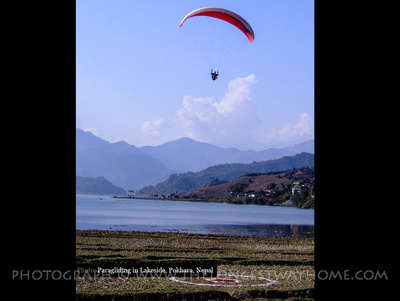 Paragliding over lake Phewa Tal in Pokhara, Nepal