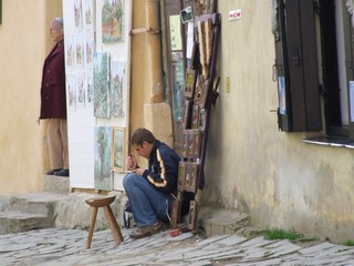 Artist painting in Romania