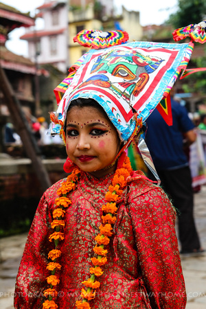 A young girl dressed as a cow during Gai Jatra
