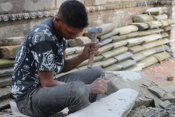 A stone mason at work in Bhaktapur Durbar Square