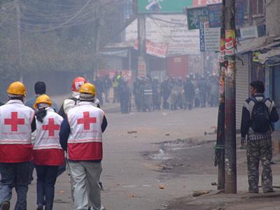 Medics walking through tear gas during riots in Kathmandu, Nepal