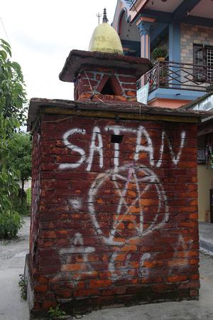Shameful graffiti on a Shiva Shrine in Pokhara