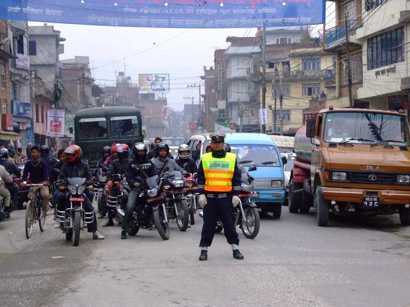 Nepal policeman stopping traffic