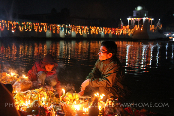 Candles are lit around the temple for Chhath
