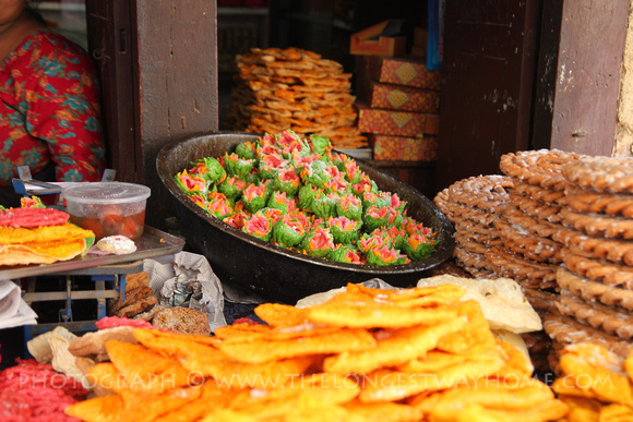 Colorful sweets are sold on the streets during Tihar
