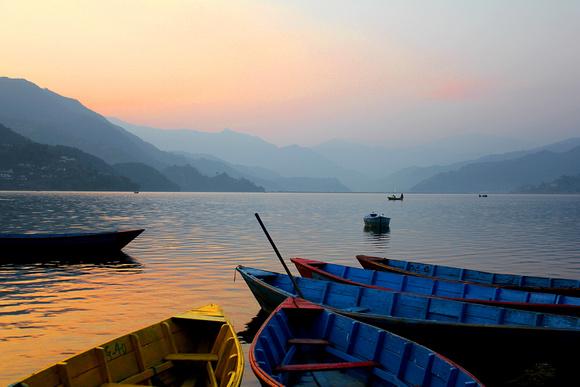 Boats at Sunset along Lake Phewa in Pokhara Lakeside, Pokhara, Nepal