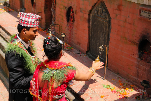 The couple walk around the courtyard giving thanks to the deities around it