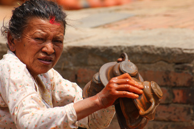 Woman dyeing pottery in Bhaktapur
