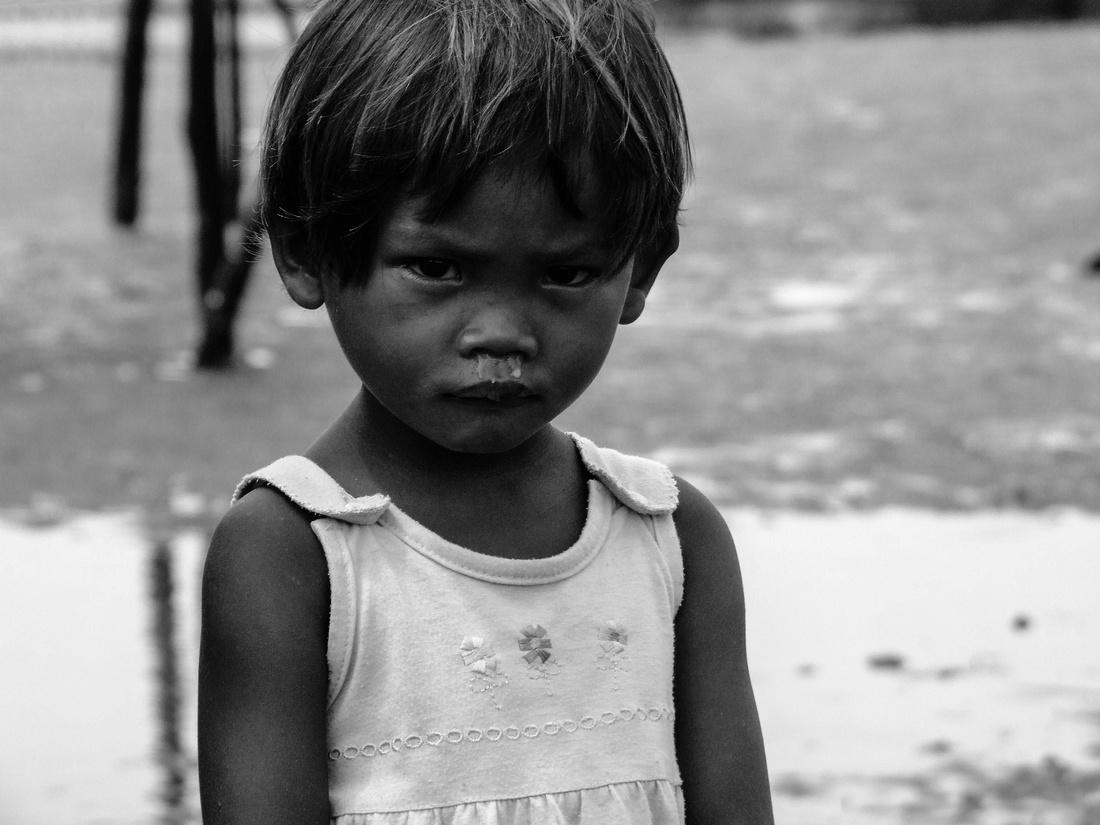 Stilt house girl from the Philippines