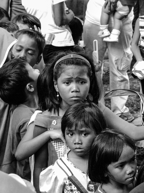 Children queuing for food after a flash flood in The Philippines