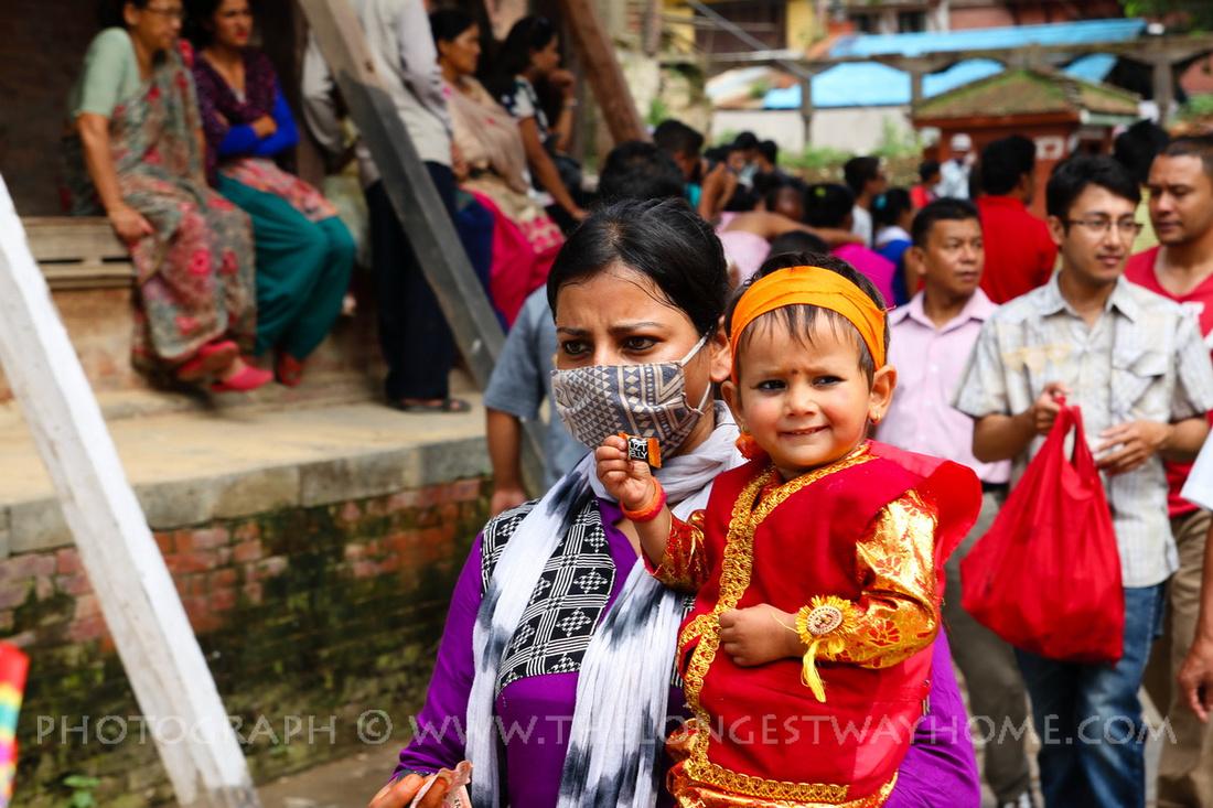 Young girl takes part in Gai Jatra