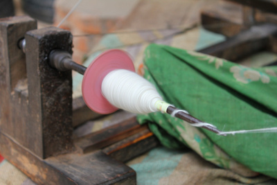 Spinning cotton on a spindle
