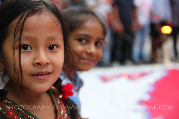 Two girls smiling at the street party in Nepal