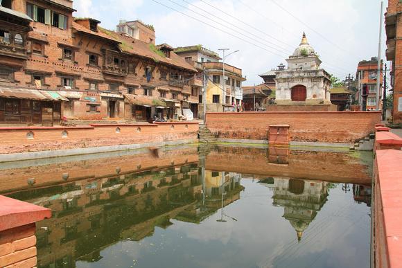 Kirtipur's Dev Pukku (pond), Royal palace and Bhairab temple (rear)