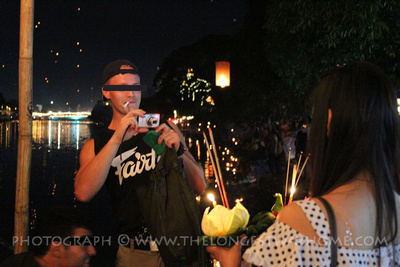 Tourists taking photos at Loi Krathong