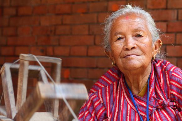 Woman yarn spinner in Nepal