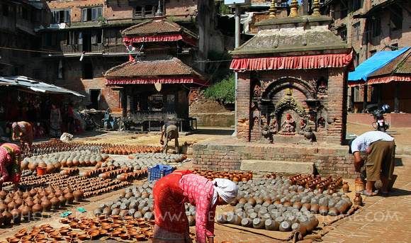 Pottery drying in front of temple in Pottery Square, Bhaktapur