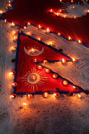Nepalese flag and butter candles lit up the roads