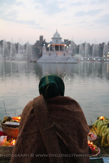 Woman sitting in front of Rani Pokhari