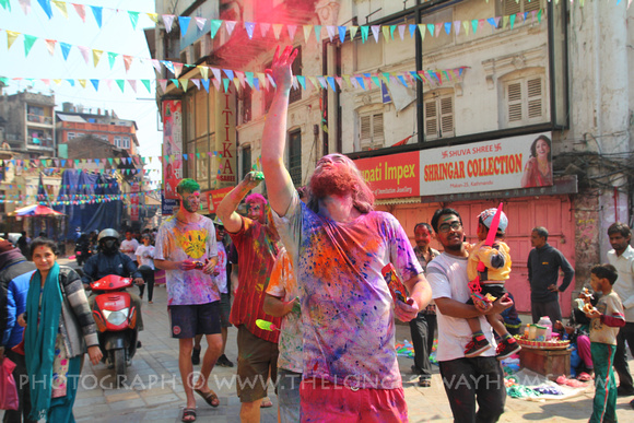 Tourist throwing color during Holi