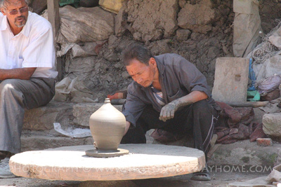 Potter using a Potter's Wheel in Pottery Square Bhaktapur