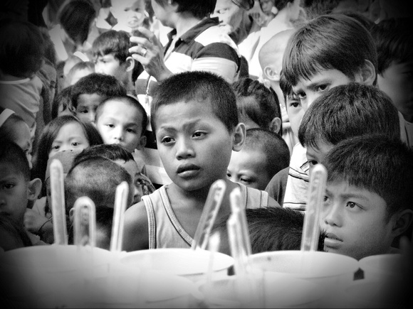 Children queuing for food aid in The Philippines