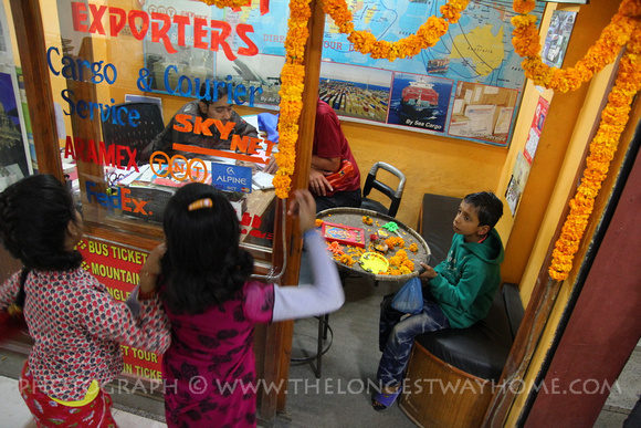 Children sing and dance outside and office during Tihar