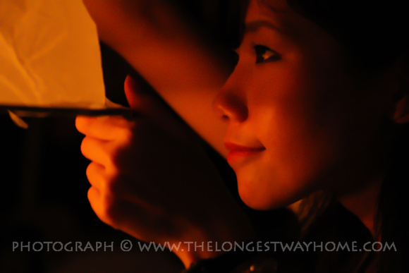 Girl looking at her sky lantern