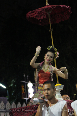 Thai lady dancing in the rain at the parade