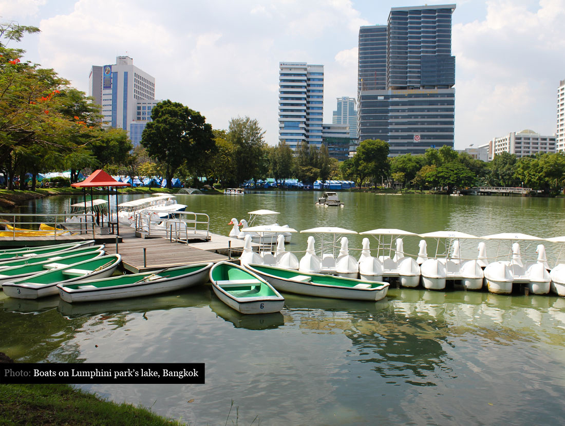 Boats on the lake in Lumphini Park in Bangkok Thailand