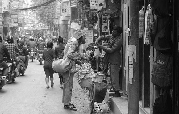 Hippie buying fruit in Thamel