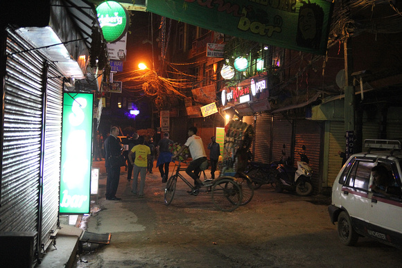 Tourist getting a rickshaw at night in Thamel