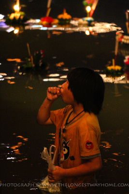 Girl working in the river Peng during Loi Krathong