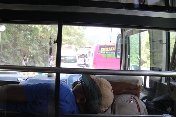 Sleeping bus driver in traffic jam in Nepal