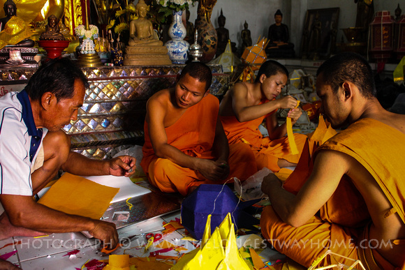 Teaching Monks how to make paper lanters