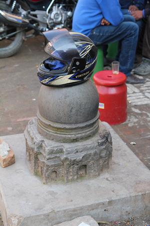 Shiva Lingam in Te Bahal, Kathmandu being used as a motorbike helment rest ...