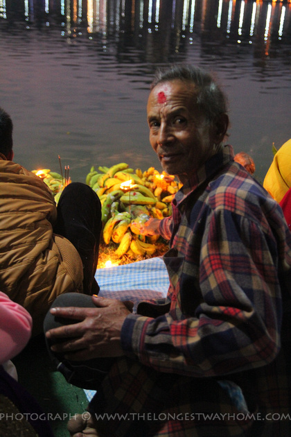 A friendly man comes to bless himself during Chhath in Kathmandu